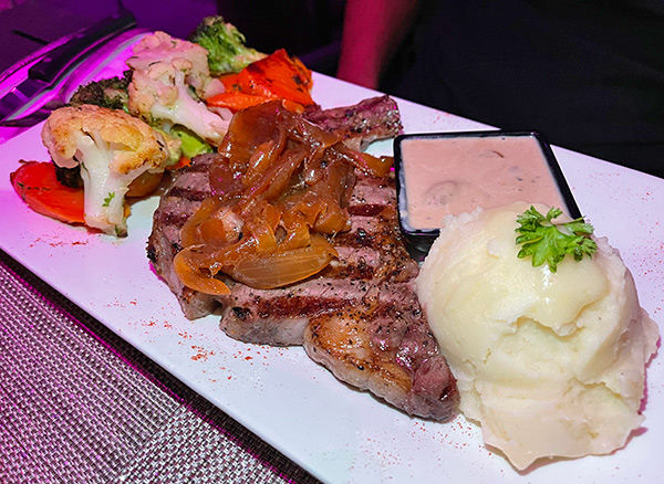 Ribeye Steak with Mushroom Sauce at Movida Rotisserie & Grill