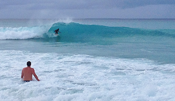 surfing on meads bay anguilla in front of bamboo bar and grill