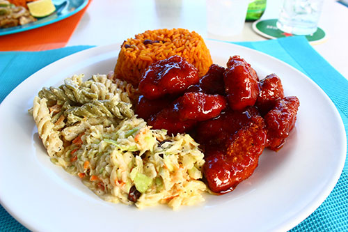 sweet and spicy chicken with rice and peas and pasta salad at sharpys