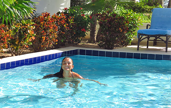 swimming in the plunge pool at private villa suite at cuisinart