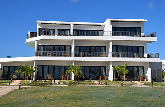 three storey beachfront buildings at the reef