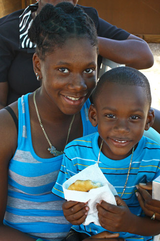 Partakers sharing a fried Johnny Cake