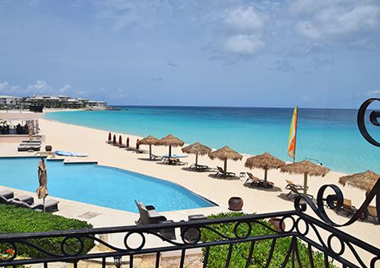 pool and beach at frangipani