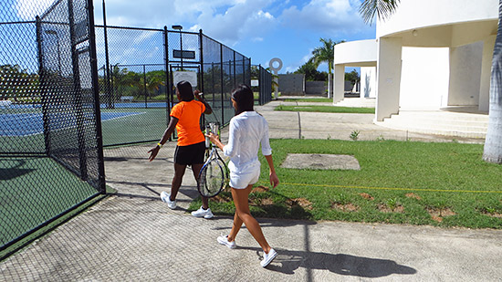 walking to the tennis court