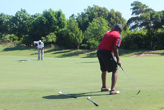 working on the short game at the anguilla golf tournament