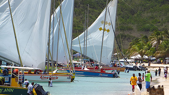 sailboats departing sandy ground