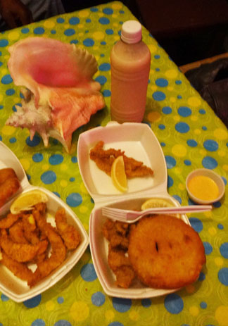 lionfish and cracked conch and johnny cakes at criss conch shack