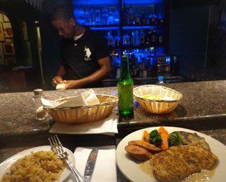 at the bar at tasty's caribbean restaurant in anguilla