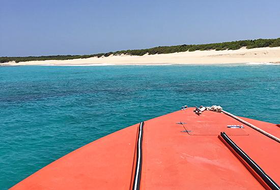 approaching scrub island beach