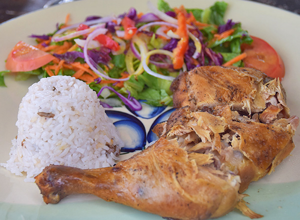 barbecue chicken with rice and peas and salad