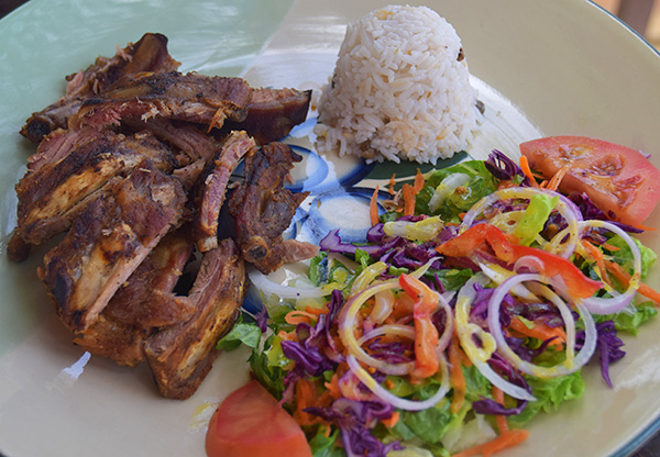ribs with rice and peas and salad