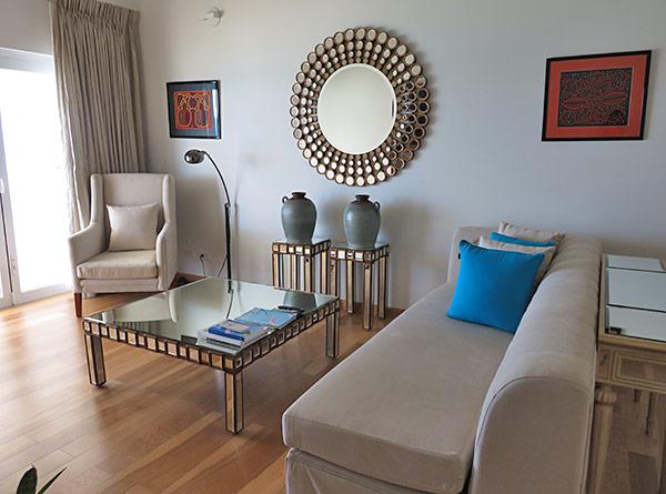 living room in beachfront superior room at manoah