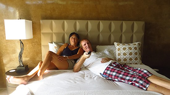 mom and dad in CéBlue bedroom