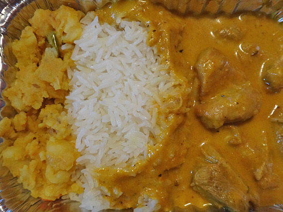 chicken korma meal with rice and potato
