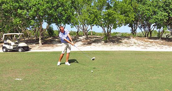 head golf pro scott delong teeing off at cuisinarts 16th hole