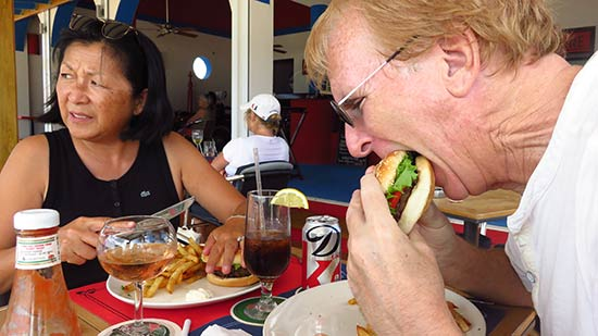 dad biting into the burger