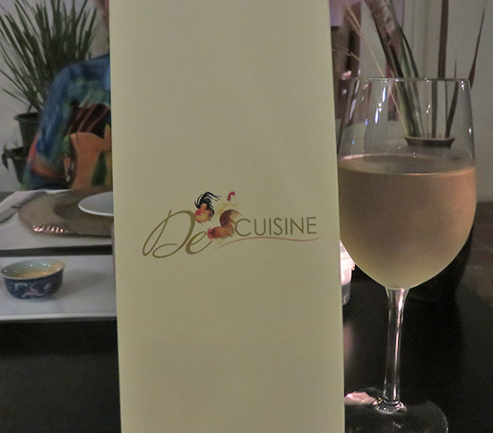 menu and a glass of wine at de cuisine