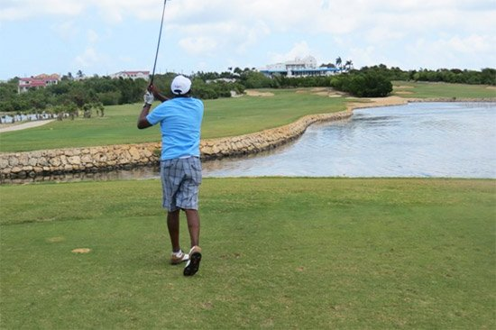 driving down hole 12 at anguilla open 2015