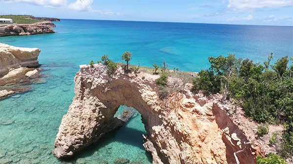 drone shot of the arch in anguilla