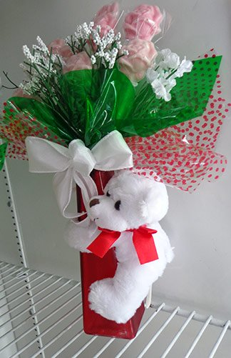 flowers with teddy bear from the gift box