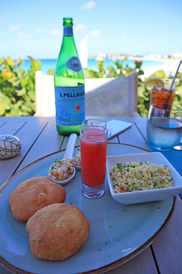 conch ceviche and johnny cakes at four seasons bamboo bar and grill