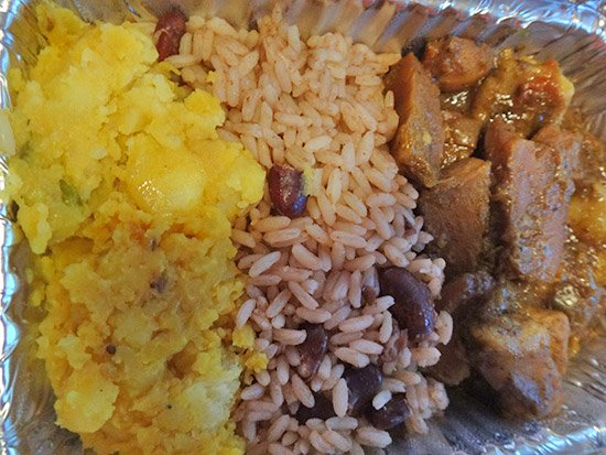 conch curry with rice and peas and bombay potato