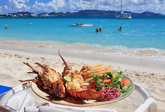 Grilled lobster and fries from Sunshine Shack beachbar N Grill