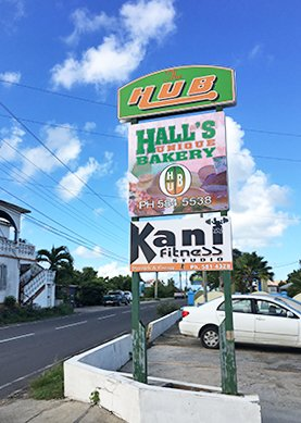 Halls Unique bakery sign from the road