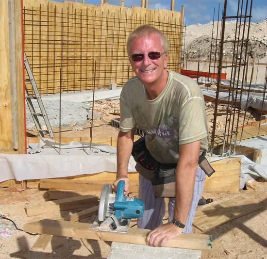 Anguilla builder Ken sawing