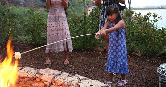 kids roasting marshmallows at malliouhana
