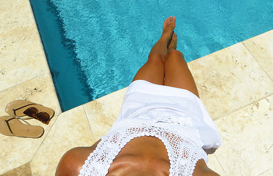 by the pool in the crochet top