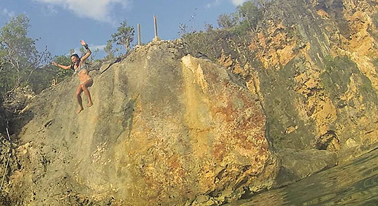 jumping off of the rock in little bay