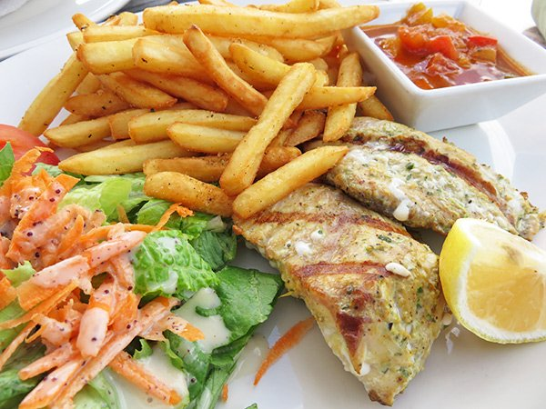 Grilled fish, fries and salad