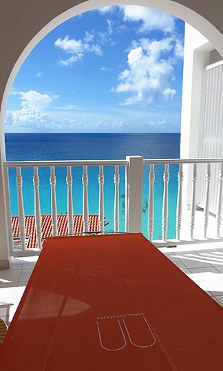 lounge chaises on balcony malliouhana