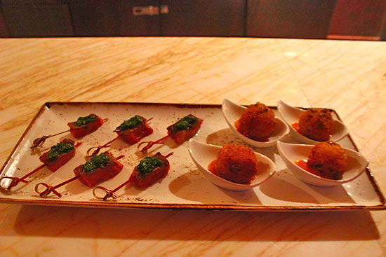 rose night hors d'oeuvres of rice and peas arancini and prime aged ribeye sate