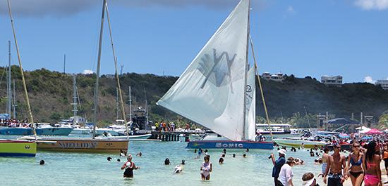 sailboats departing sandy ground