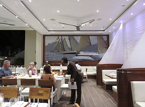 the dining room lay out inside the yacht club at the reef