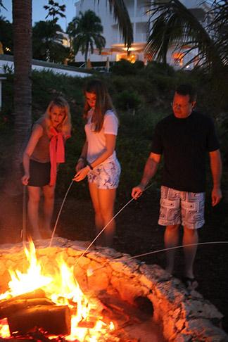 roasting marshmallows on an open fire