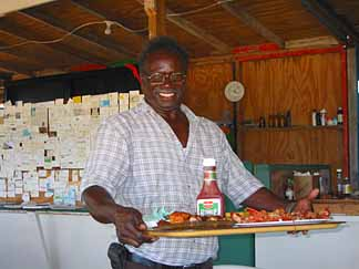 Anguilla restaurants Nat with tray