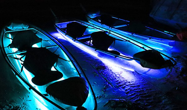 Liquid Glow night kayaking on LED light transperant kayaks