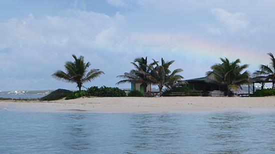 rainbow over sandy island