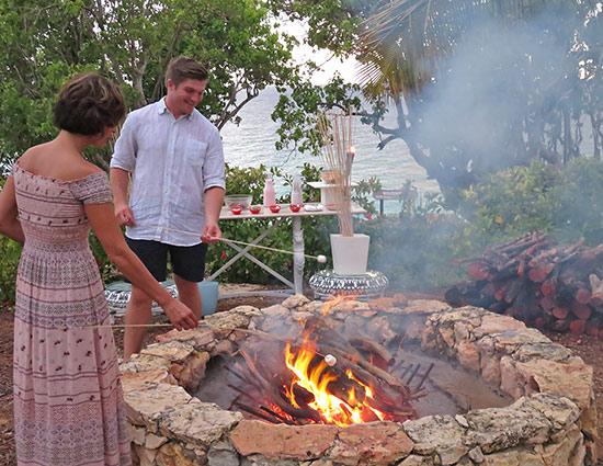 roasting marshmallows on an open fire at malliouhana
