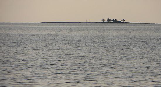 sandy island at sunset