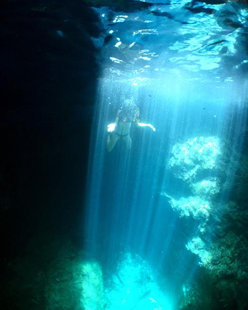 sunrays inside scrub island sea cave