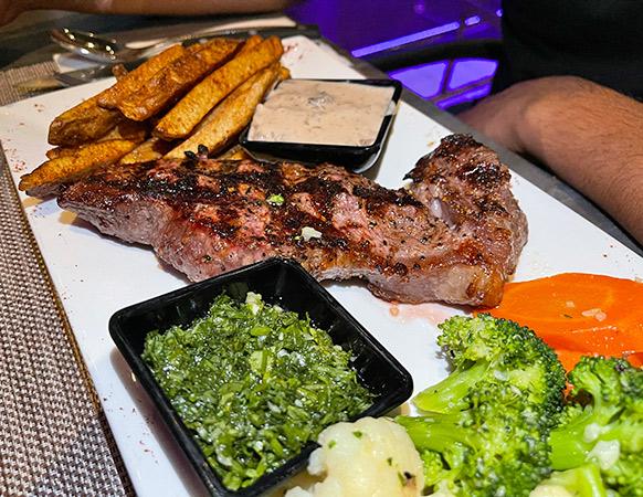 Ribeye Steak with Peppercorn & Chimichurri at Movida Rotisserie & Grill