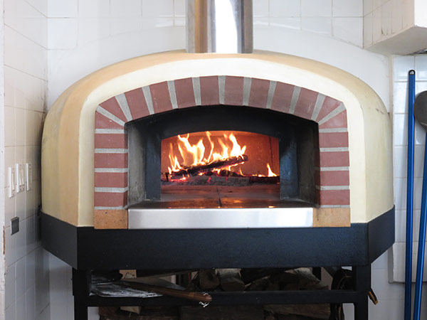 the famous woodfire oven at covecastles