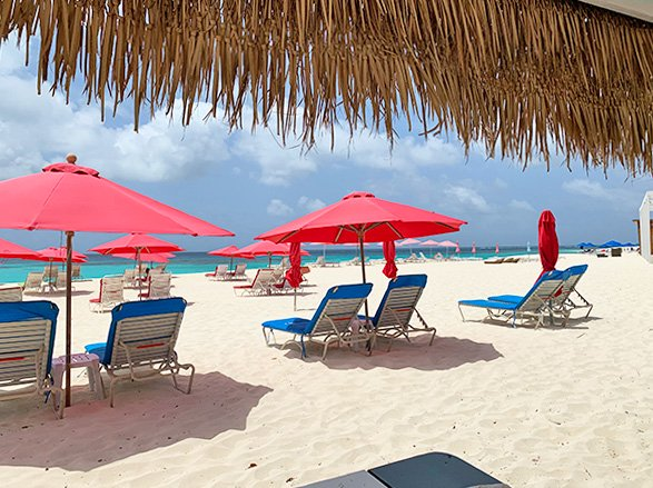 view from uncle ernies beach bar of umbrellas and the water of shoal bay, anguilla