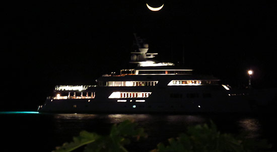 yacht and moon seen from malliouhana in meads bay