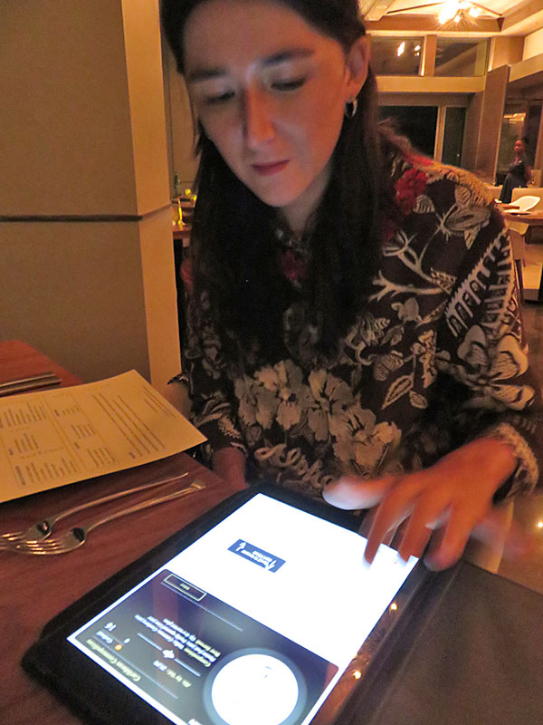 wine selection presented via tablet at coba four seasons