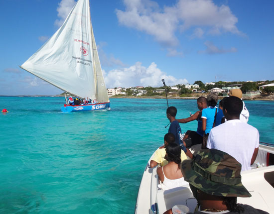 zharnel hughes following anguilla's national sport of boat racing